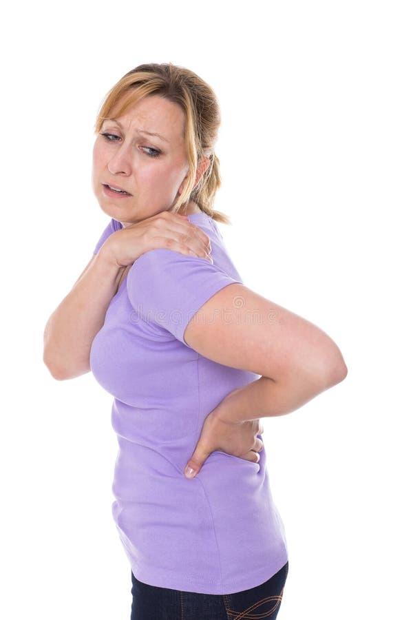 Donna con dolore della spalla immagini stock libere da diritti