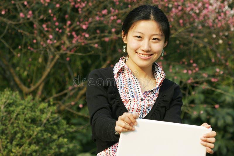 Donna con er loptop fotografia stock