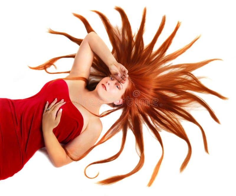 Donna con i capelli di colore rosso dello starburst immagini stock libere da diritti