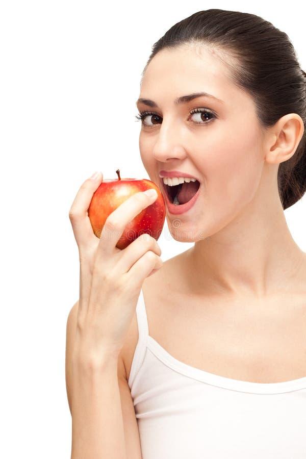 Donna con i denti e la mela bianchi immagini stock