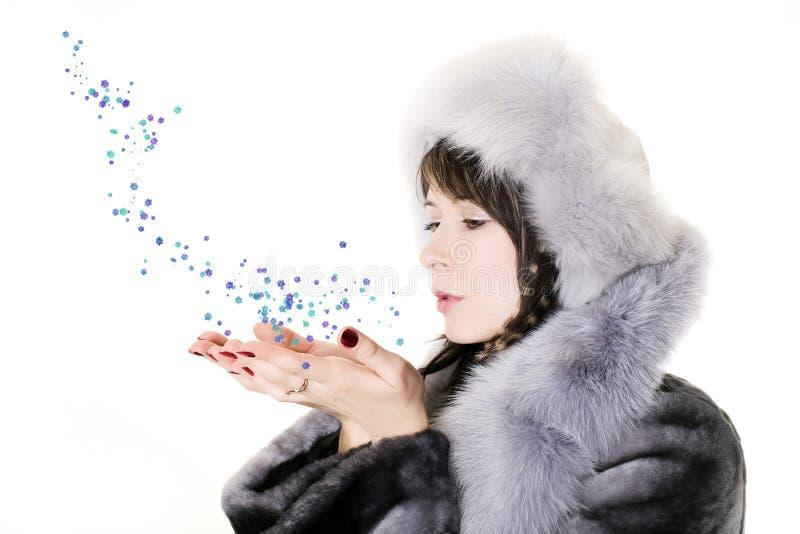 Donna con i fiocchi di neve fotografia stock libera da diritti
