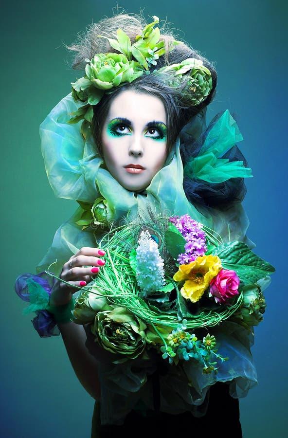 Donna con i fiori fotografia stock