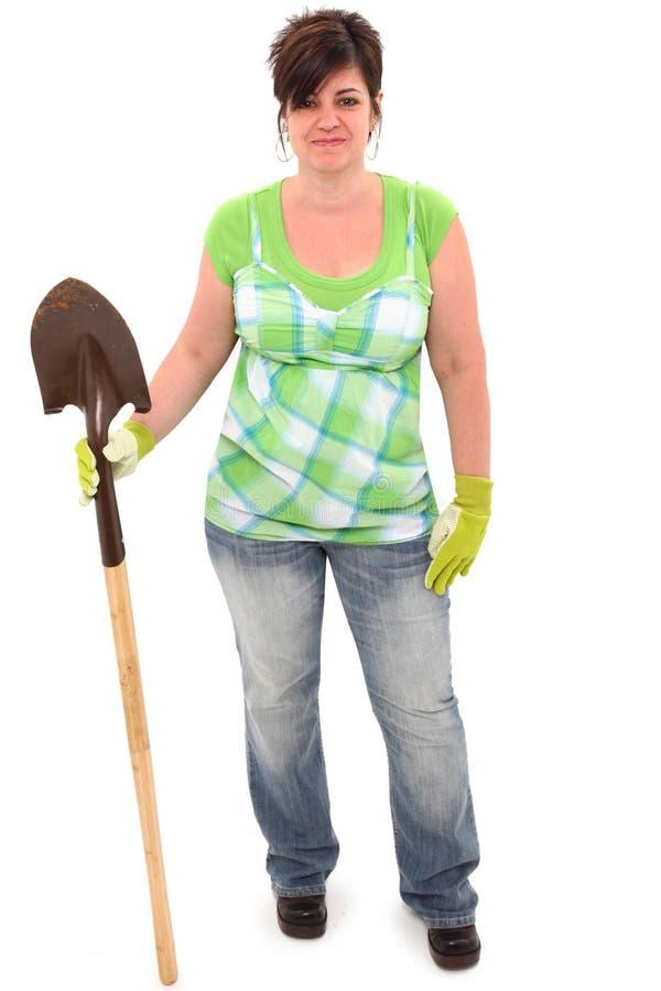 Donna con i guanti del giardino e della pala fotografia stock libera da diritti