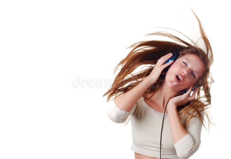 Donna con i headpfones immagine stock