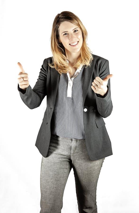 Donna con i pollici in su fotografia stock libera da diritti