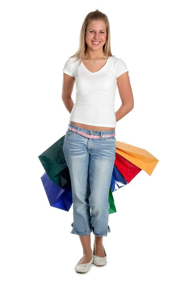 Donna con i sacchetti di acquisto fotografie stock