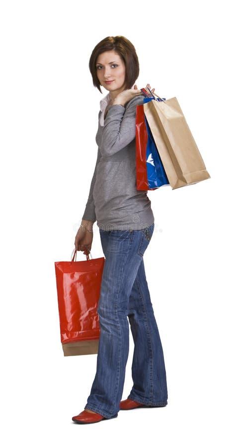 Download Donna Con I Sacchetti Di Acquisto Immagine Stock - Immagine di lusso, divertimento: 7324351