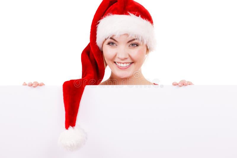 Donna con il bordo vuoto in bianco dell'insegna Natale immagini stock libere da diritti