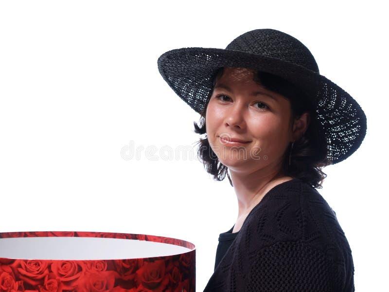 Donna con il cappello immagine stock