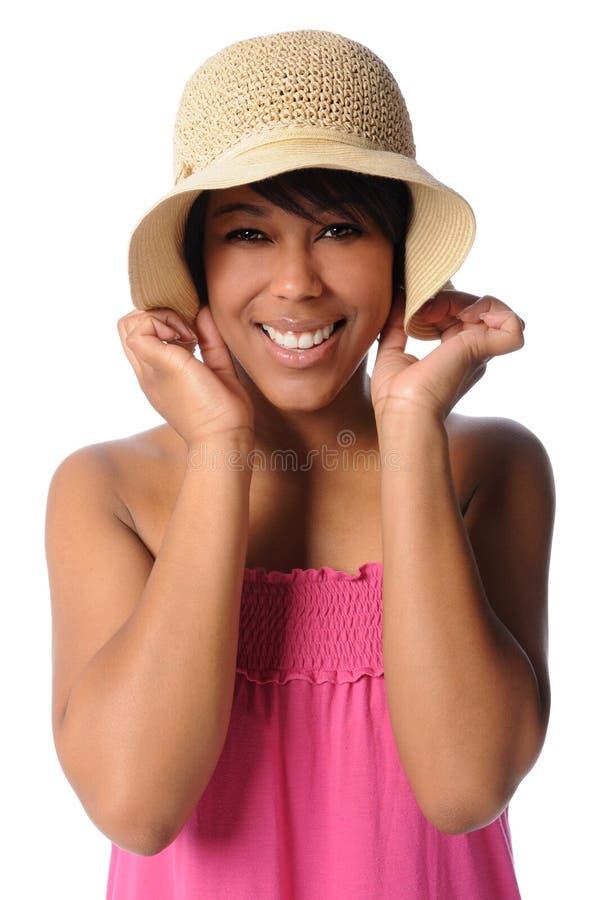 Donna con il cappello di paglia immagini stock