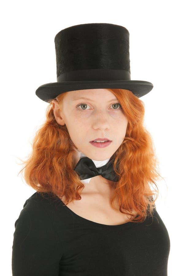 Donna con il cappello di seta nero fotografia stock libera da diritti