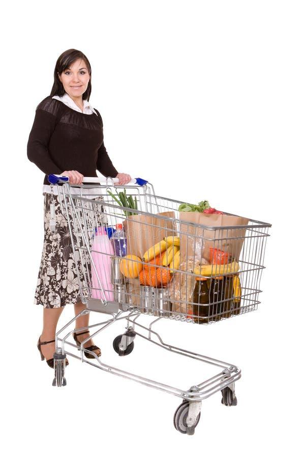 Donna con il carrello di acquisto immagine stock libera da diritti