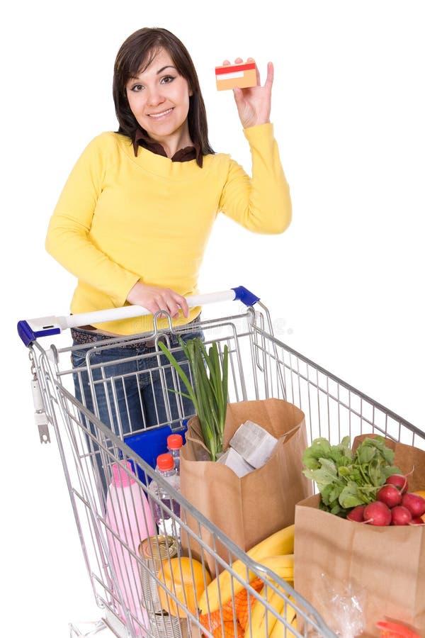 Donna con il carrello di acquisto fotografia stock libera da diritti