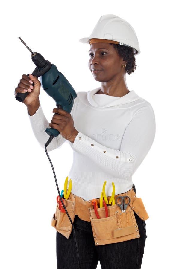 Donna con il casco e gli strumenti immagini stock
