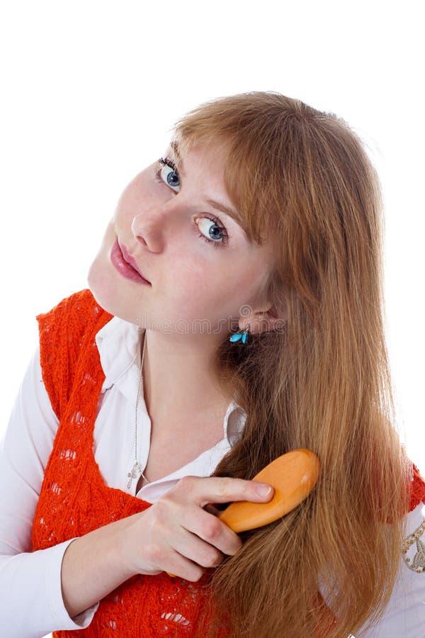 Donna con il hairbrush fotografie stock