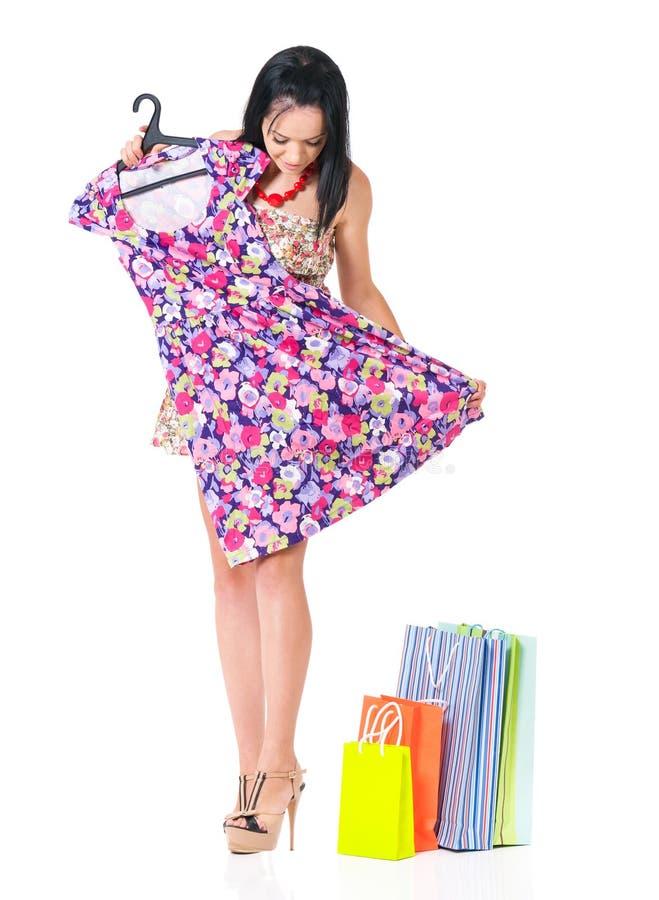 Donna con il nuovo vestito immagine stock libera da diritti