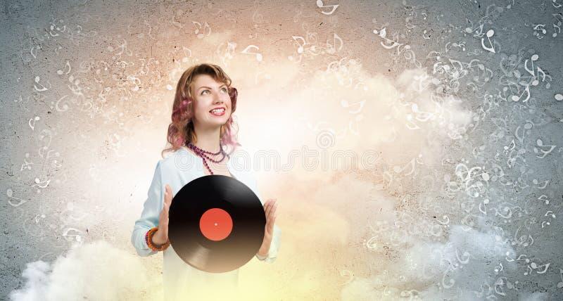 Donna con il piatto della discoteca immagini stock