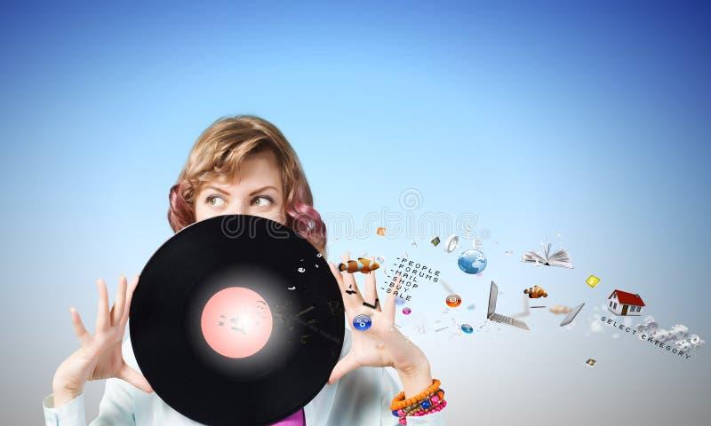 Donna con il piatto della discoteca fotografia stock libera da diritti