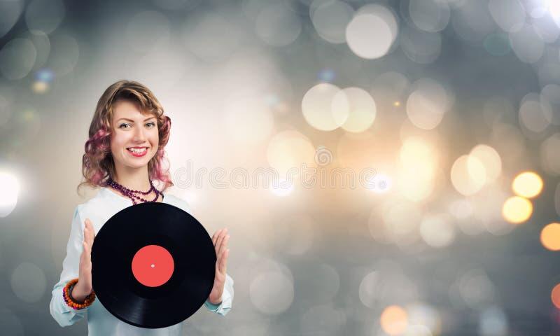 Donna con il piatto della discoteca immagine stock libera da diritti