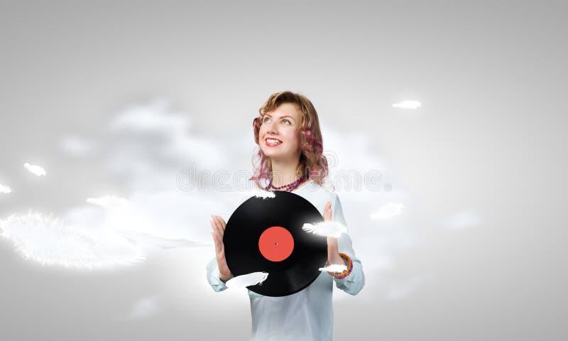 Donna con il piatto della discoteca immagine stock