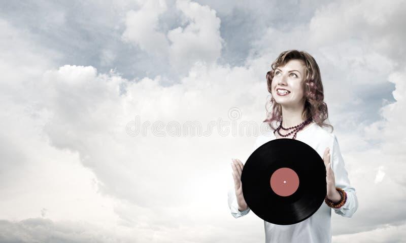 Donna con il piatto della discoteca fotografie stock
