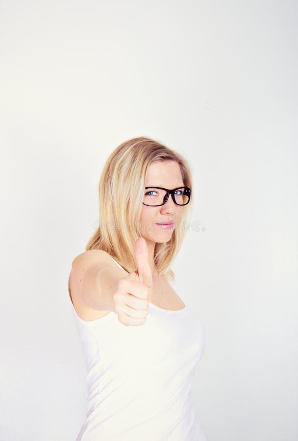 Donna con il pollice in su fotografie stock libere da diritti