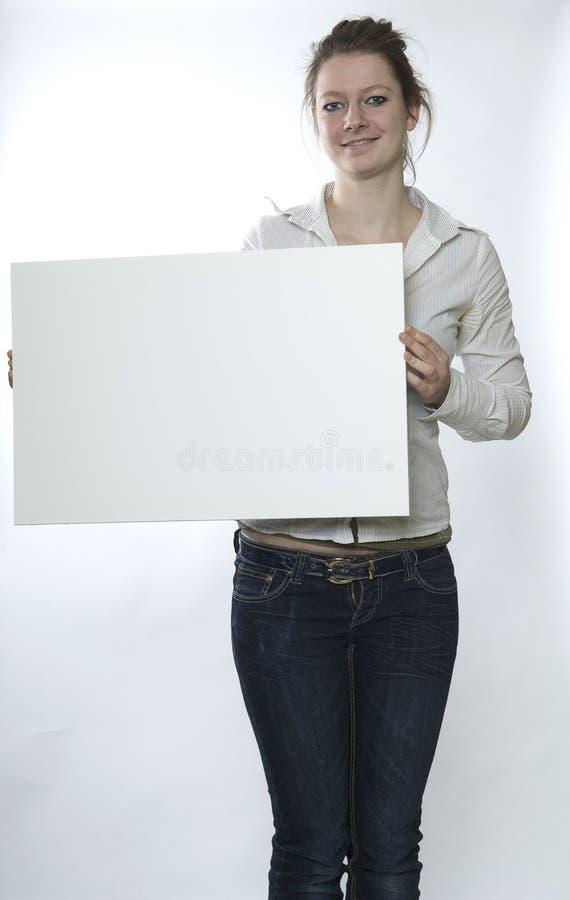 Donna con il segno bianco immagini stock libere da diritti
