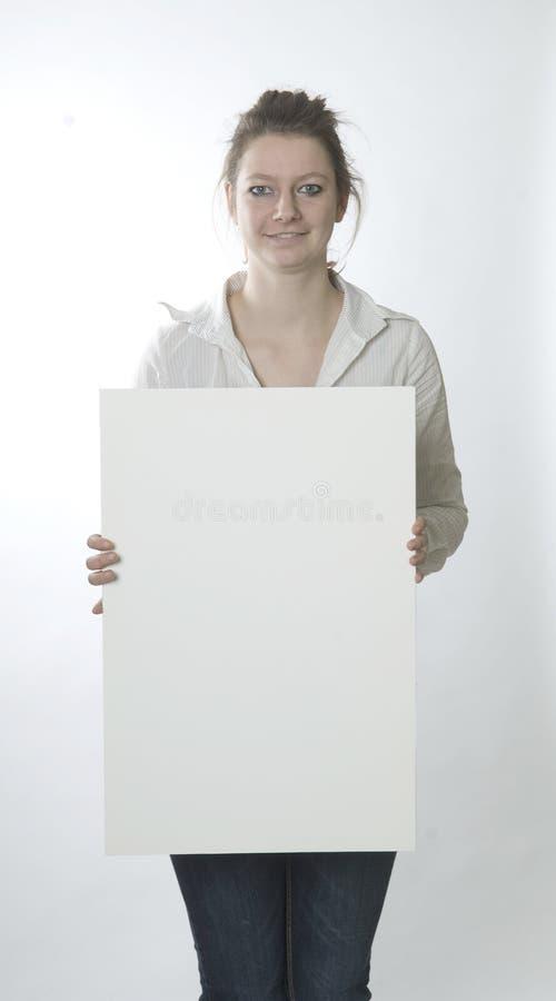 Donna con il segno bianco fotografie stock libere da diritti