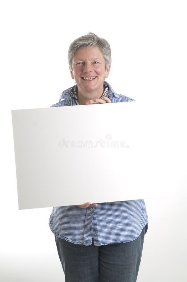 Donna con il segno bianco fotografia stock libera da diritti