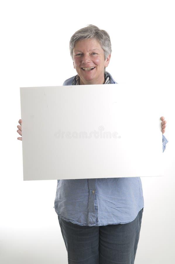 Donna con il segno bianco fotografia stock