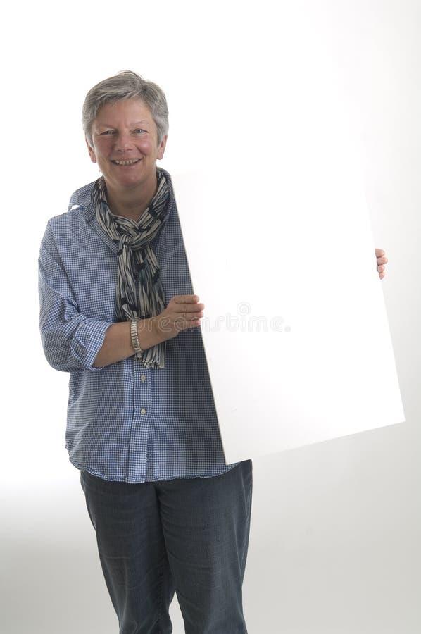 Donna con il segno bianco immagini stock