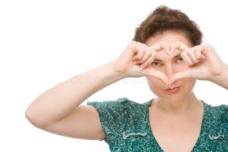 Donna con il segno del cuore immagini stock