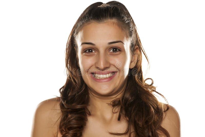 Donna con il sorriso esagerato fotografia stock
