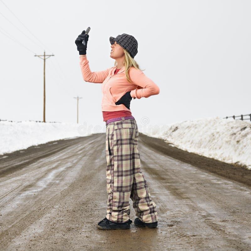Donna con il telefono delle cellule. fotografie stock libere da diritti