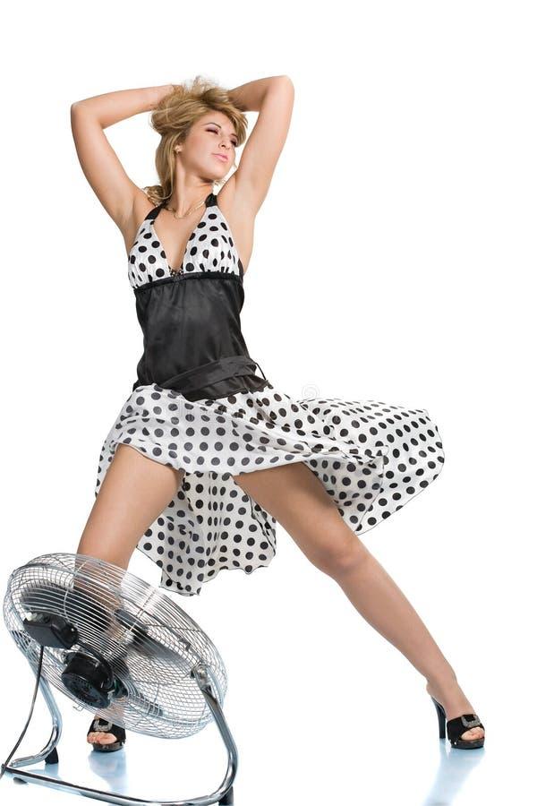 Donna con il ventilatore immagine stock libera da diritti