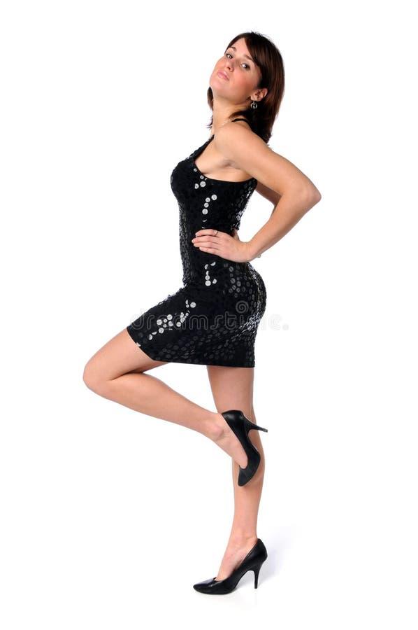 Donna con il vestito ed i talloni immagine stock libera da diritti