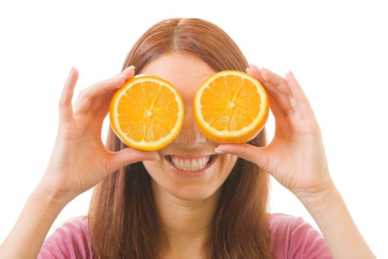 Donna con l'arancio, isolato immagini stock libere da diritti
