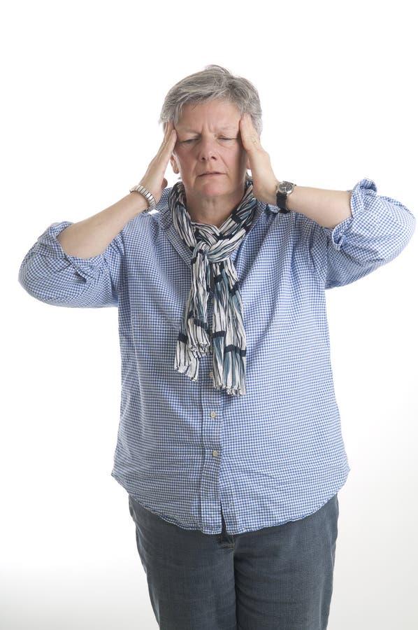 Donna con l'emicrania immagini stock