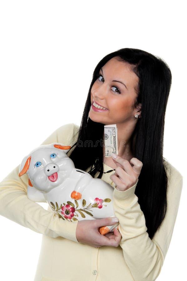 Donna con la banca piggy e la fattura del dollaro. Salvo. fotografia stock