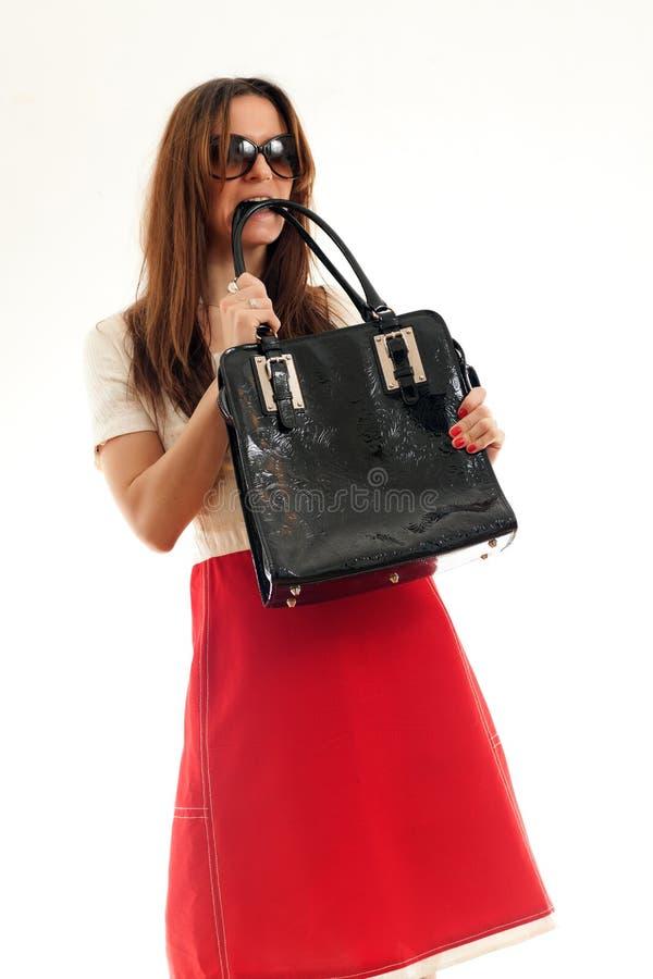 Donna con la borsa di cuoio fotografia stock libera da diritti