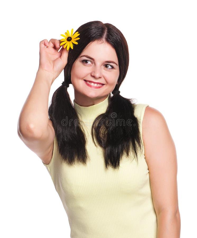Donna con la camomilla fotografia stock