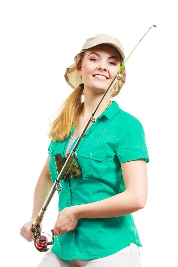 Donna con la canna da pesca, attrezzatura di filatura immagine stock