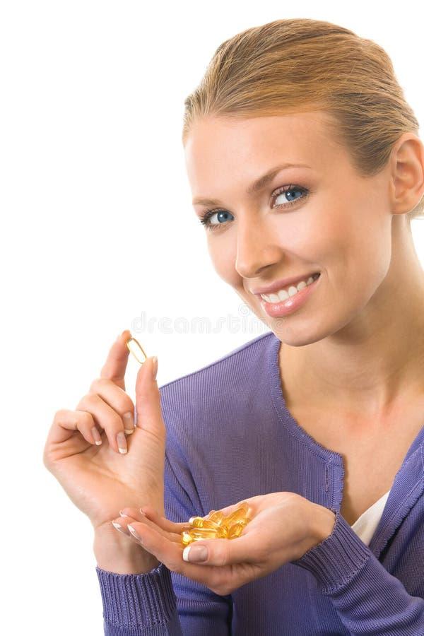 Donna con la capsula dell'olio di pesce immagine stock