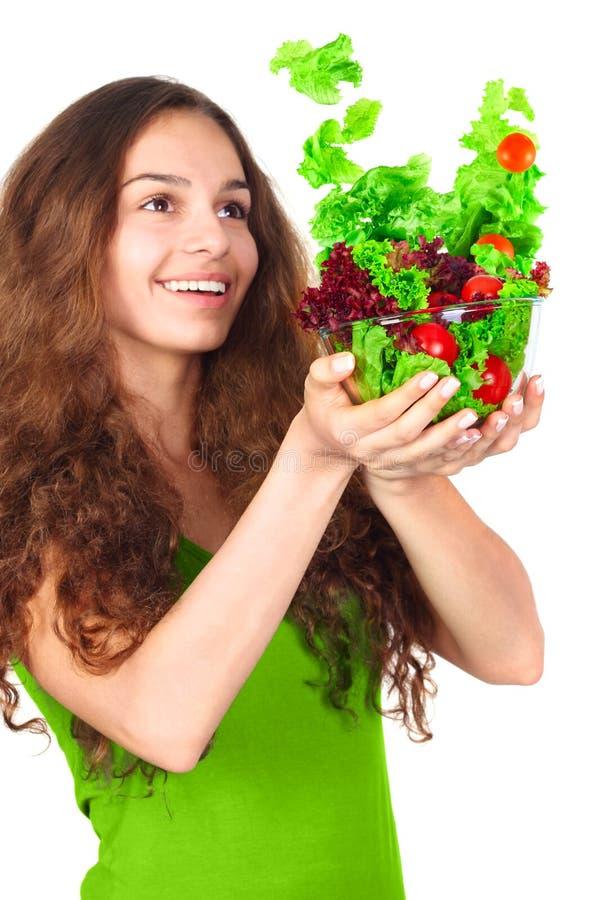 Donna con la ciotola di insalata immagini stock