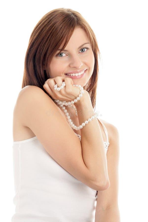 Donna con la collana della perla immagine stock