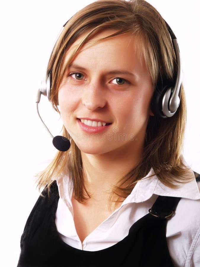 Donna con la cuffia avricolare immagini stock libere da diritti