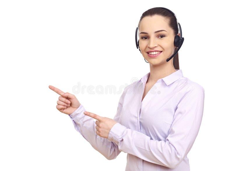 Donna con la cuffia avricolare che gesturing con le mani fotografia stock libera da diritti