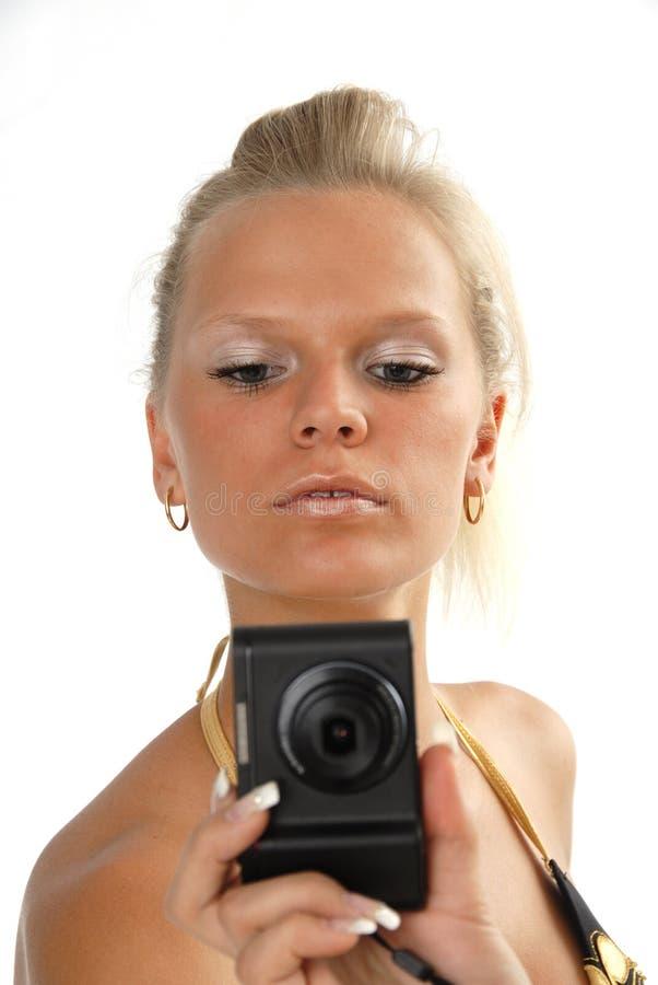 Donna con la macchina fotografica immagine stock