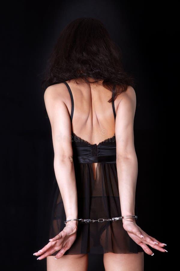 Donna con la manetta fotografie stock libere da diritti