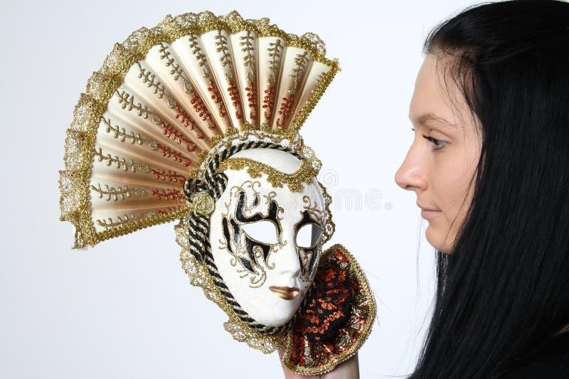 Donna con la mascherina fotografia stock